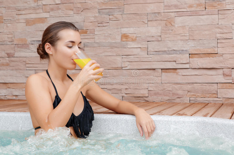 Woman spends time in a Jacuzzi royalty free stock image