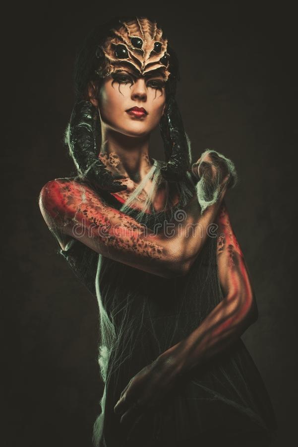 Woman with spider body art stock photos