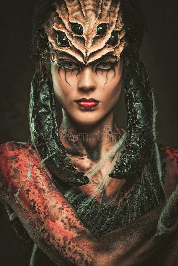 Woman with spider body art. Young woman with spider body art and mask royalty free stock image