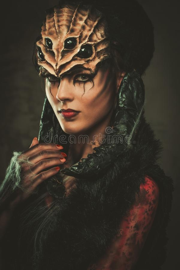 Woman with spider body art. Young woman with spider body art and mask stock photos