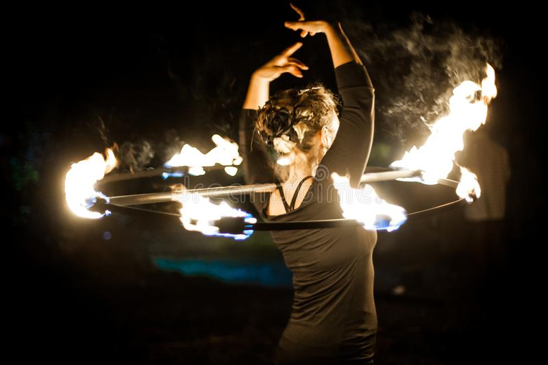 Woman dancing with fire royalty free stock images