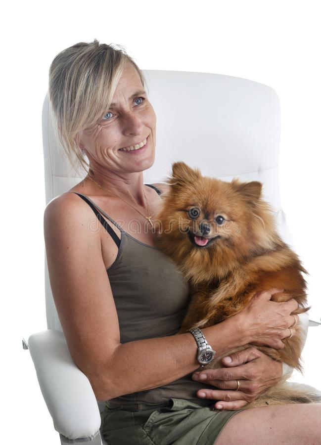 Woman and spitz. Pomeranian spitz and woman in front of white background stock images