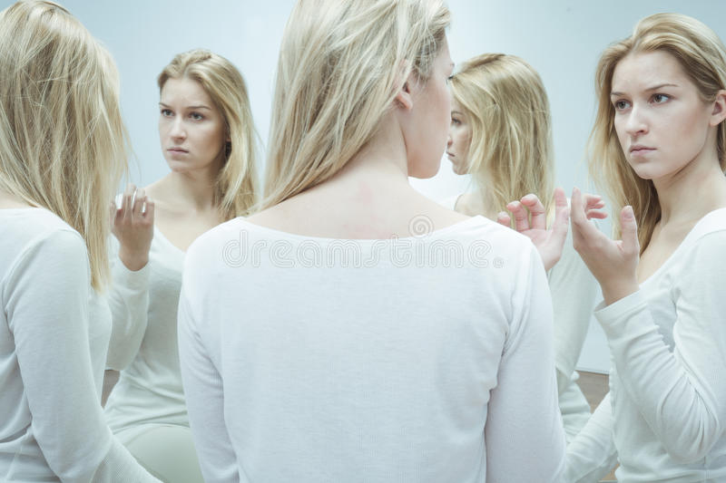 Woman with split personality stock image
