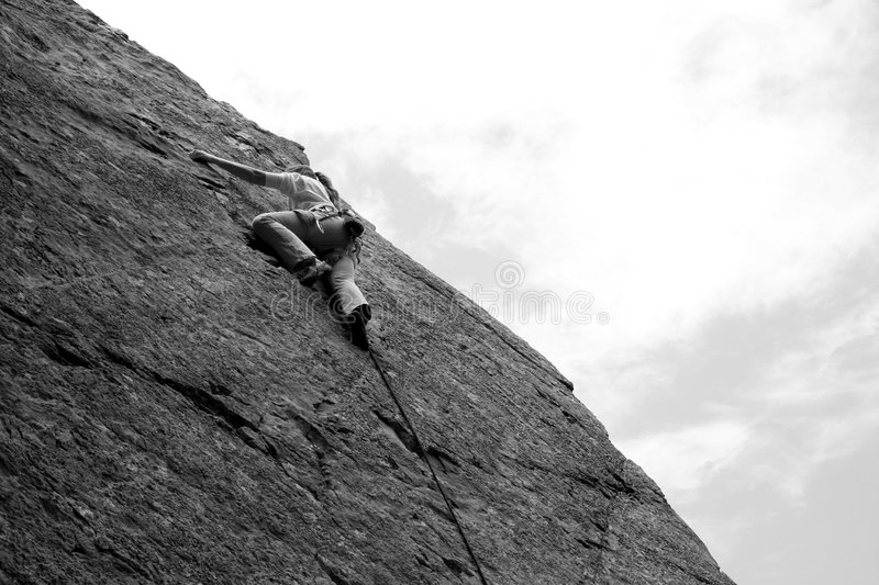 Woman sport climber 2. A woman sport climber in black and white 2 royalty free stock photography