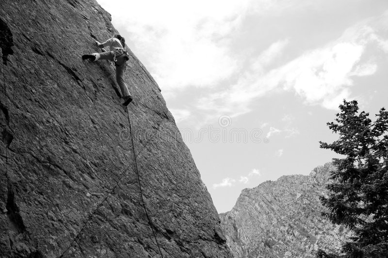 Woman sport climber. A woman sport climber in black and white stock images