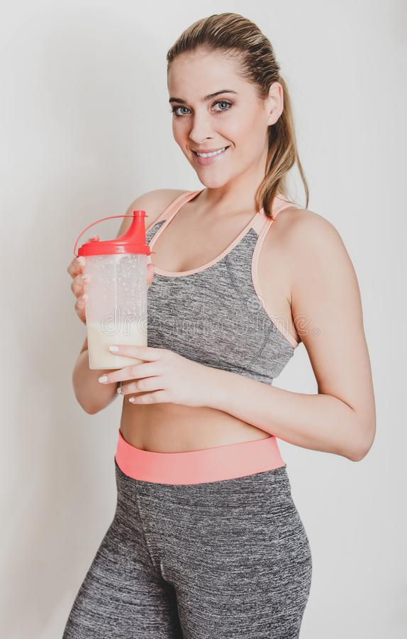 Woman with protein cocktail royalty free stock images