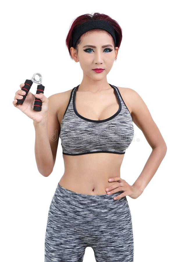 Woman in sport. Young asian woman in gray fitness clothes stock photos