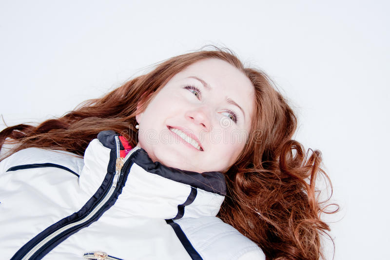 Download Woman In A Sporting Suit Lies On To Snow Stock Photo - Image of nature, merry: 19520204
