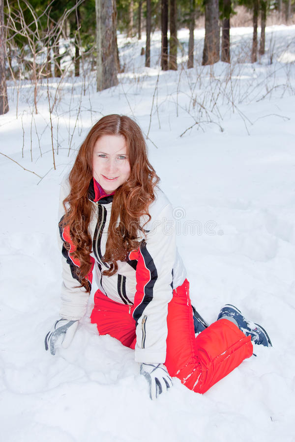 Download Woman In A Sporting Suit Sits On To Snow  In-field Stock Photo - Image: 19520256