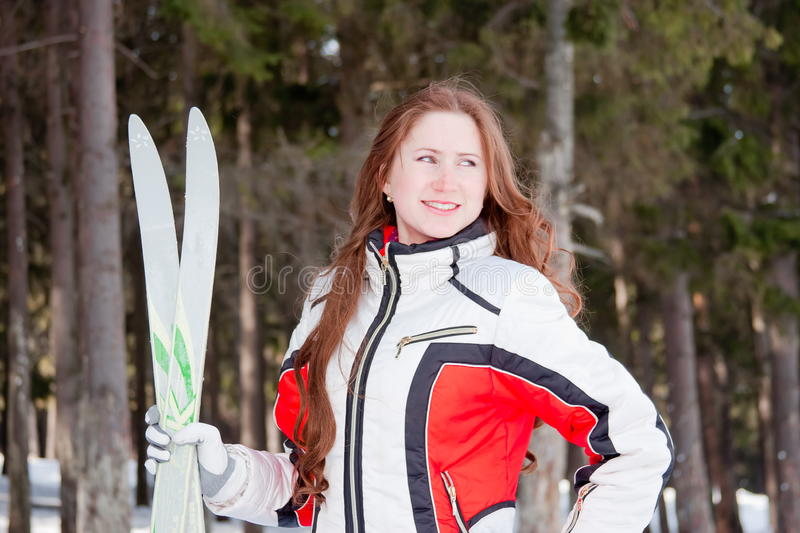 Download Woman In A Sporting Suit With Skis In-field Stock Photo - Image: 19520002