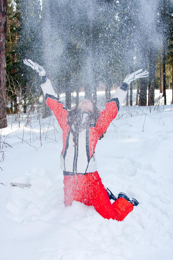 Download Woman In A Sporting Suit Tosses Up Snow  In-field Stock Image - Image: 19520271