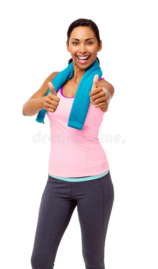 Woman In Sports Clothing Gesturing Thumbs Up stock photos