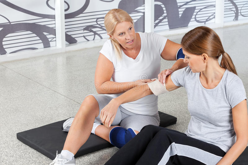 Woman with sports injury gets First royalty free stock photos
