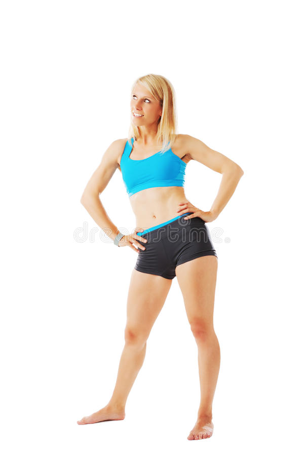 Woman in sports wear standing with hands on her hips stock images