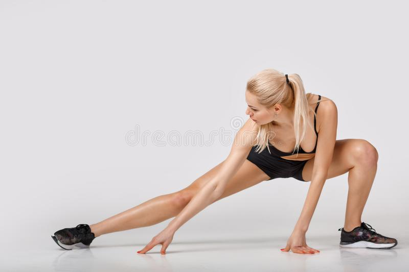 Woman in sportswear does exercises royalty free stock image