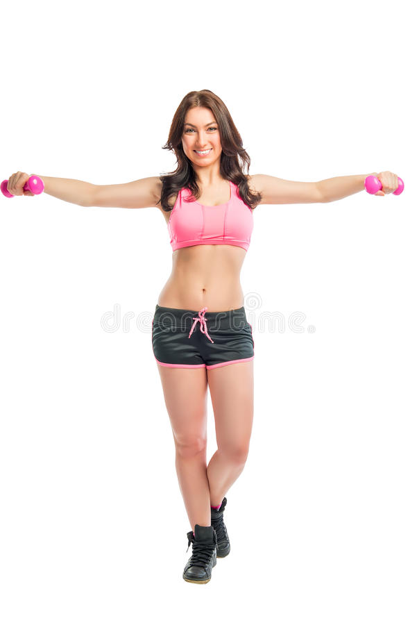 Woman in sportswear with dumbbells. On a white background royalty free stock image