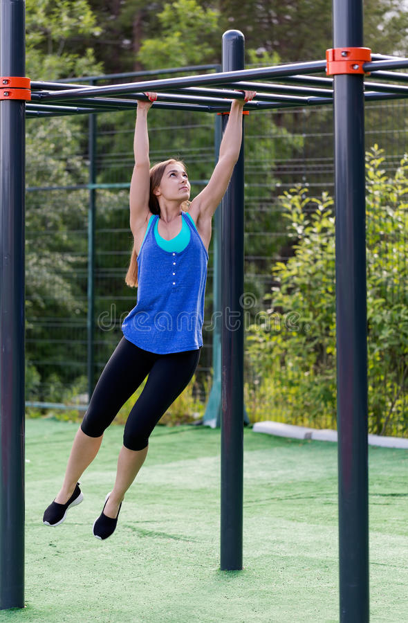Woman in sportswear on the playground stock images