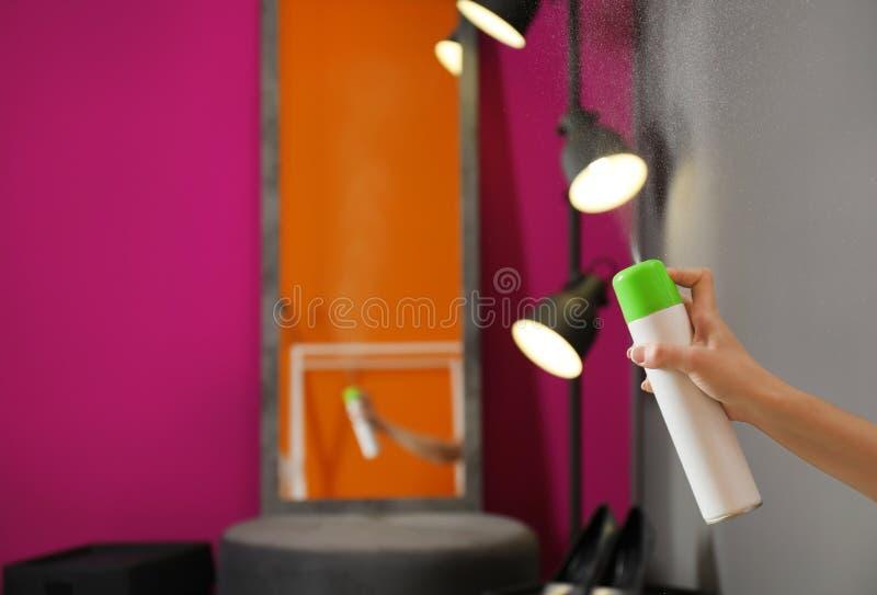 Woman spraying air freshener at home, closeup. Woman spraying air freshener at home royalty free stock photography