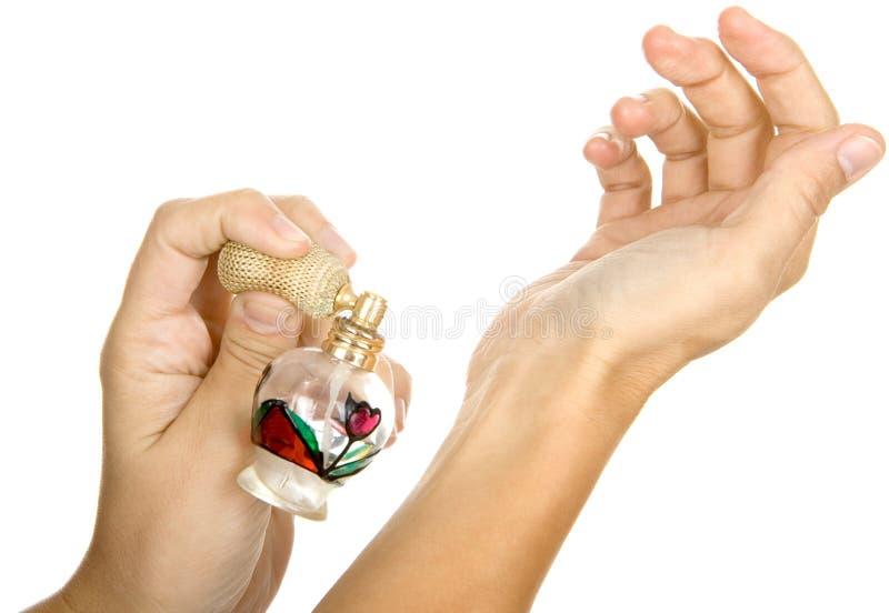 Woman spraying parfume