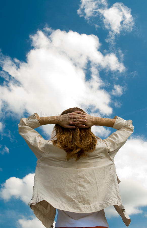 Woman spreading arms to sky royalty free stock photos