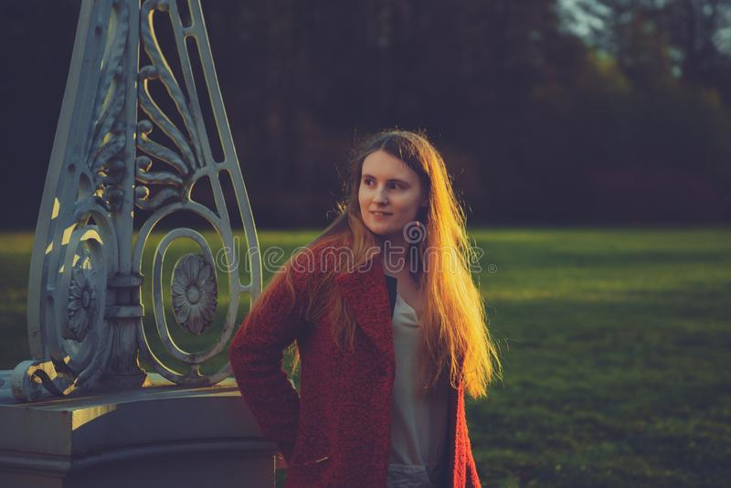 Woman in the spring park. beautiful girl portrait in sunset royalty free stock photo