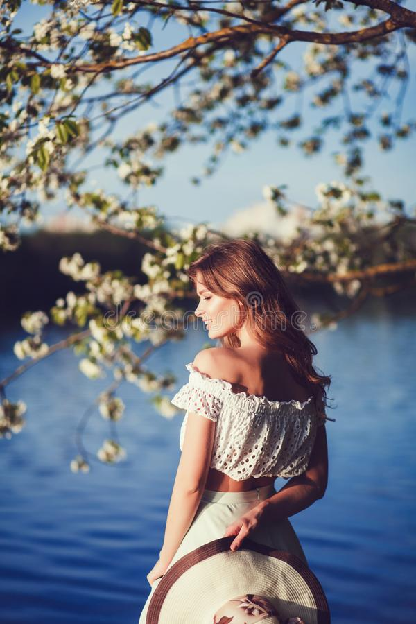 Woman in spring park. Happy smiling young woman in spring park outdoors royalty free stock images