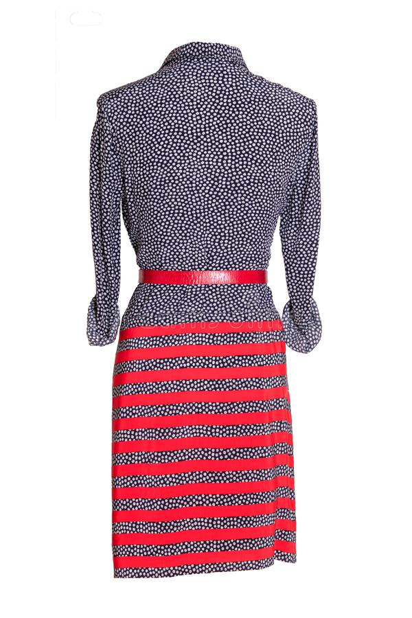Woman spring summer dress. Women`s blue and red striped dress with a red belt on a mannequin isolated on a white background. royalty free stock photos