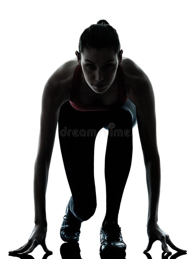 Woman sprinter on starting block