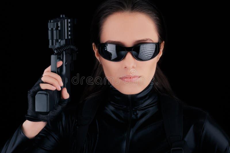 Woman Spy Holding Gun royalty free stock image