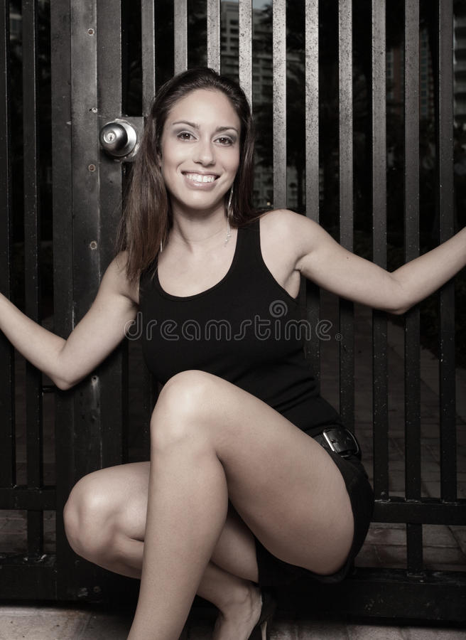 Woman squatting and smiling stock photos