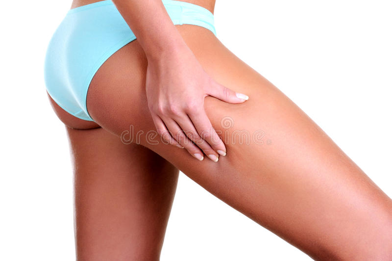 Download Woman Squeezes A Skin On A Hip Stock Image - Image: 11756503