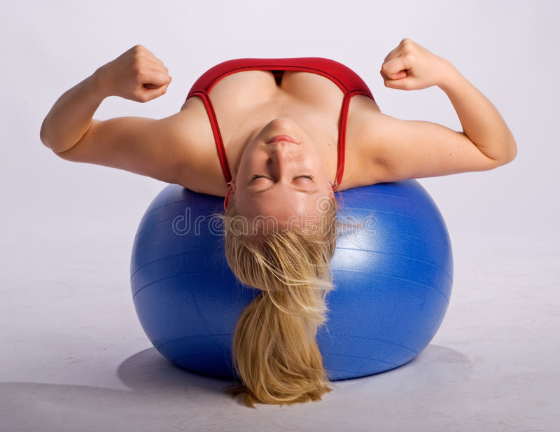 Woman On Stability Ball Makes Fists Stock Image
