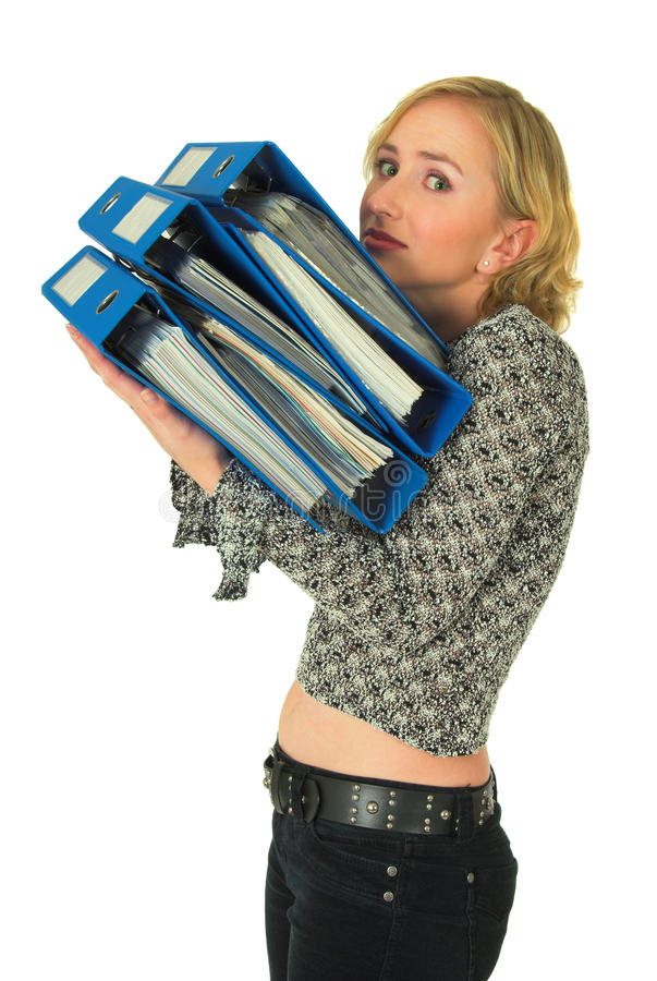 Woman with stack of folders. Side half body portrait of attractive young woman carrying stack or pile of folders and files royalty free stock images