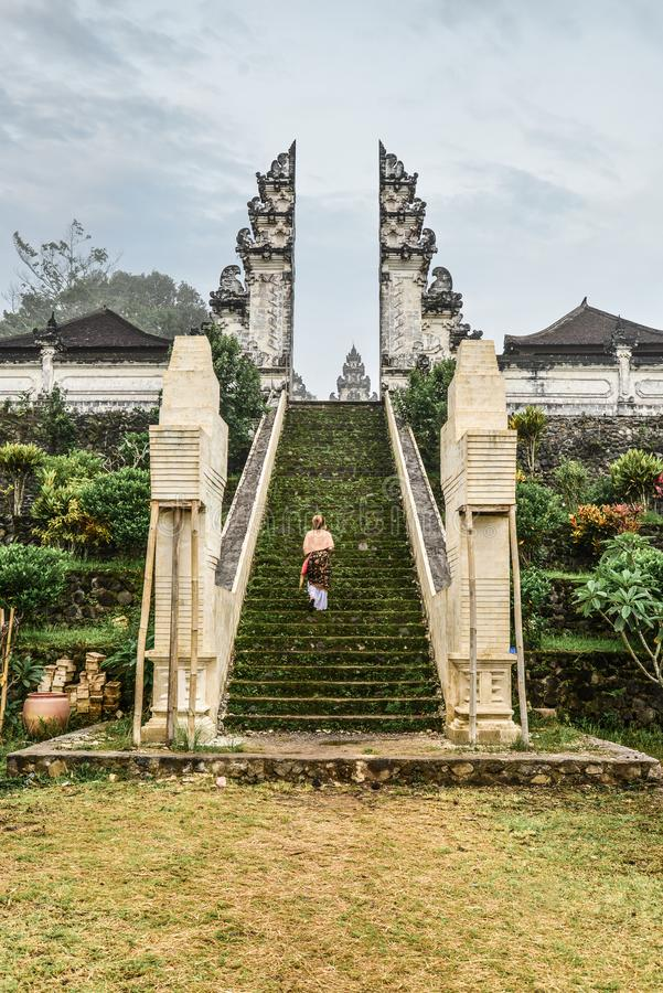 Woman on stairs to the entrance to the Pura Lempuyang temple royalty free stock photos
