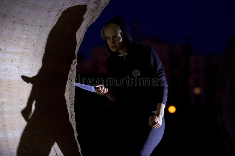 Download Woman stalking with knife stock photo. Image of defends - 32254372