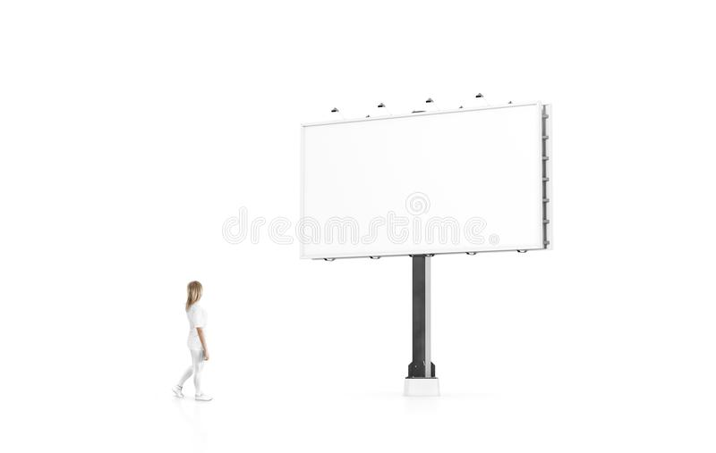 Woman stand beside blank white banner mock up city billboard stock photo