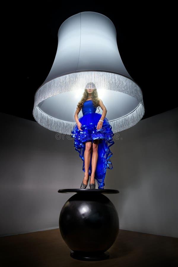 Free Woman - Standard Lamp Royalty Free Stock Image - 31347926