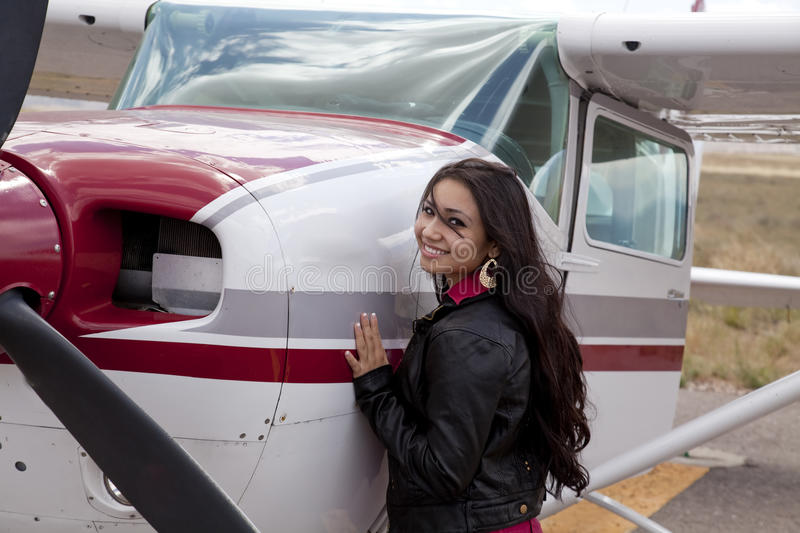 Download Woman Standing By Airplane Cowling Stock Image - Image: 16150125