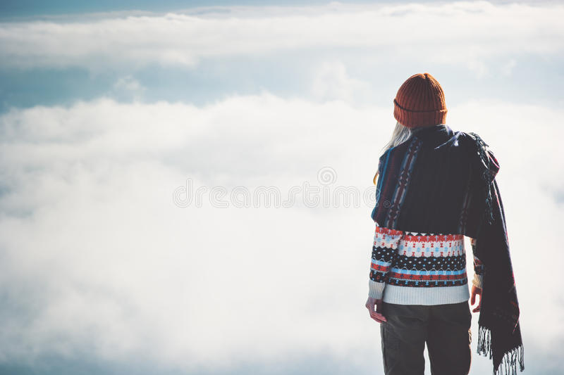 Woman standing alone sky clouds landscape. On background Travel Lifestyle concept adventure vacations outdoor happy emotions stock photos