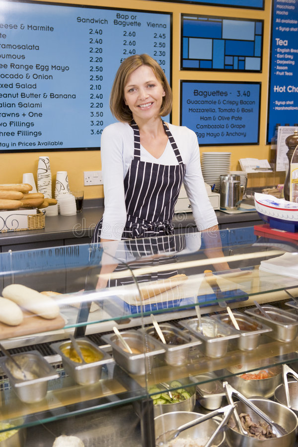 Free Woman Standing At Counter In Restaurant Smiling Stock Photos - 5940433