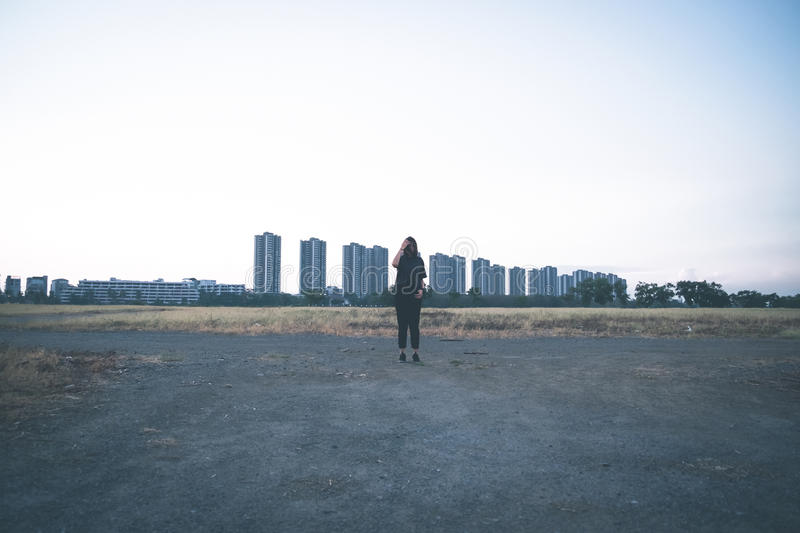 Download Woman Standing Behind The Big Building Stock Photo - Image of solo, woman: 82960768