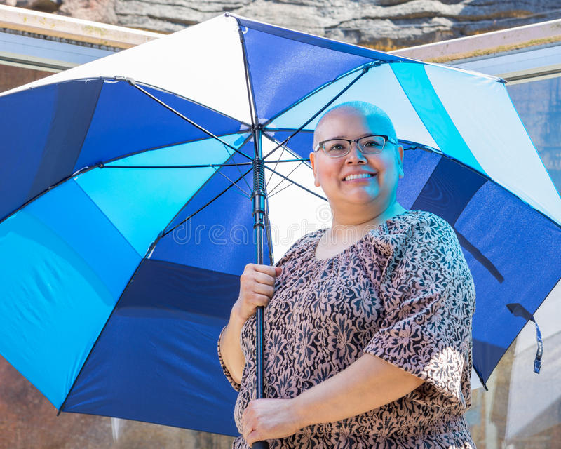 Woman Standing Beneath Umbrella For Protection From Sun stock photography