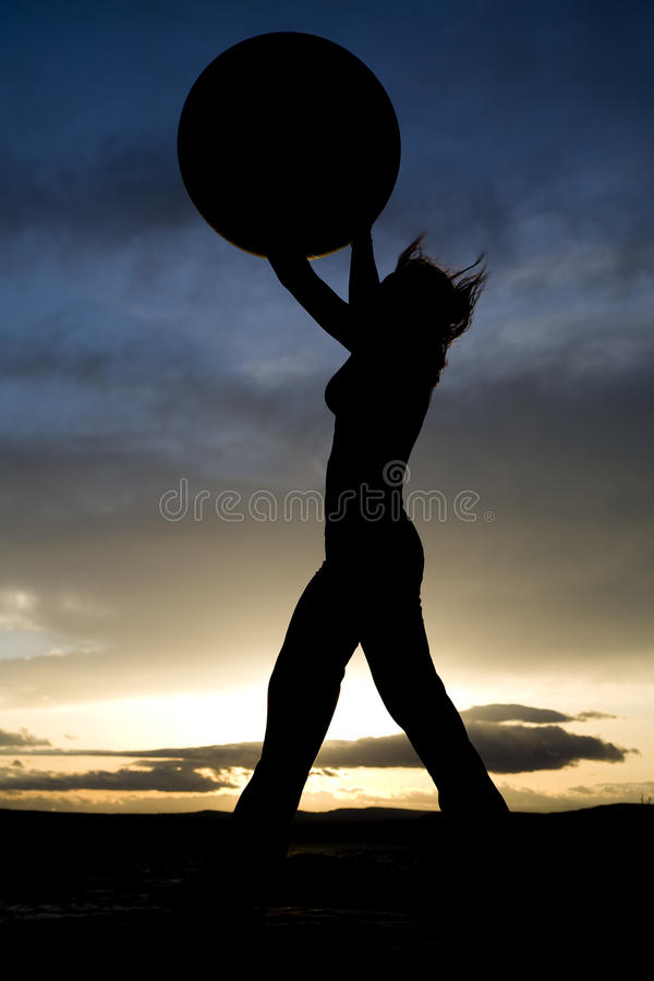 Woman Standing With Big Ball Silhouette Royalty Free Stock Image