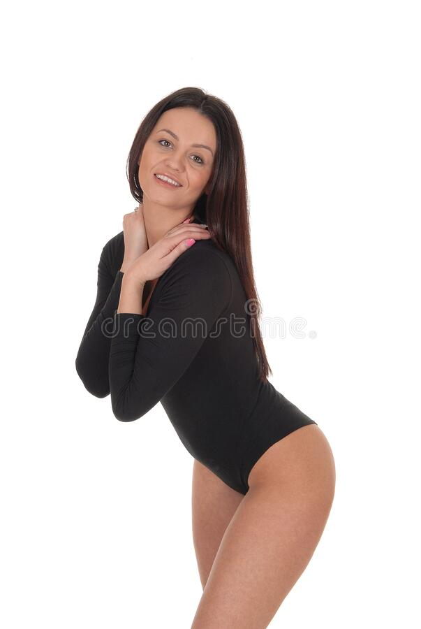 Woman standing in a black body suit from the front royalty free stock photography