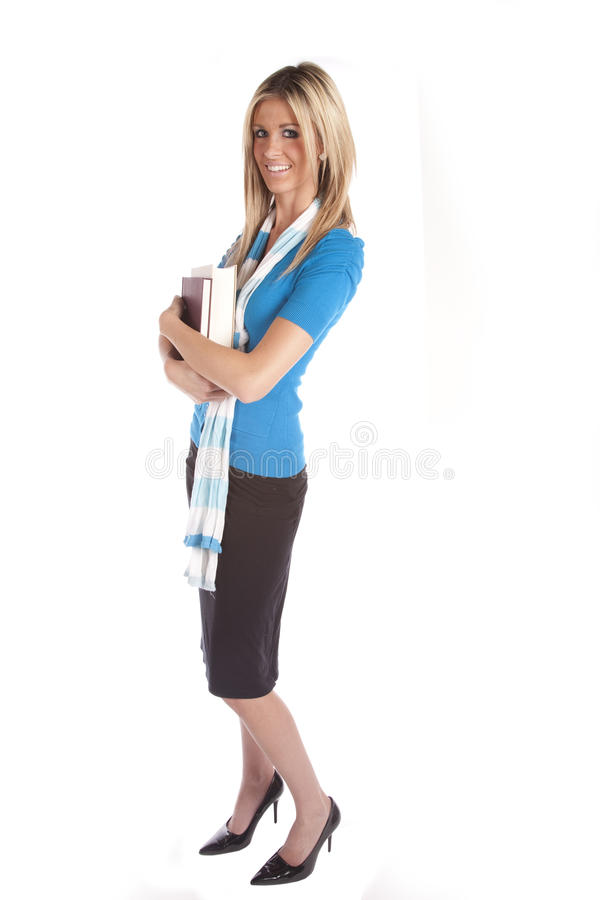 Woman standing with books stock photo