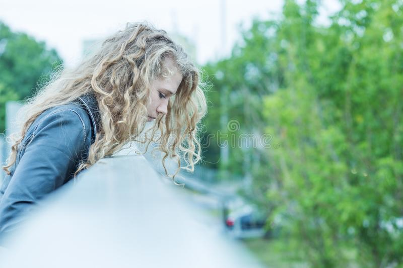 Woman standing on the bridge stock image