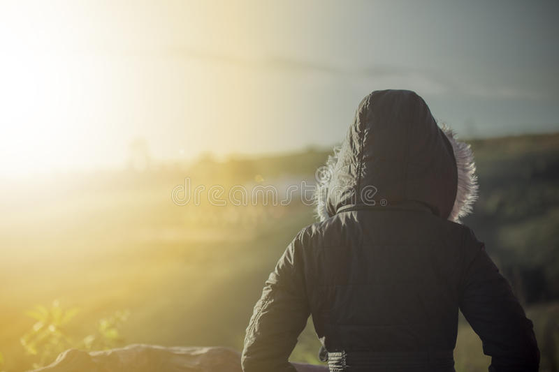 Woman standing in the cold weather stock photo