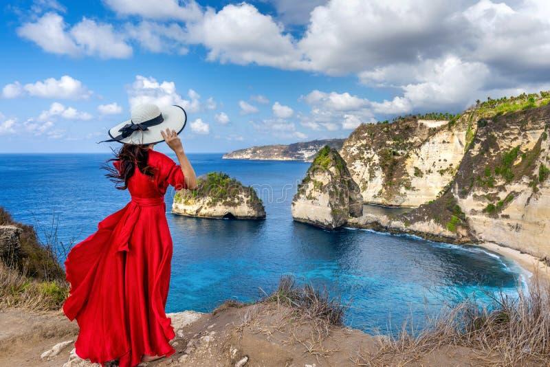 Woman standing on Diamond beach in Nusa penida island, Bali in Indonesia. royalty free stock images