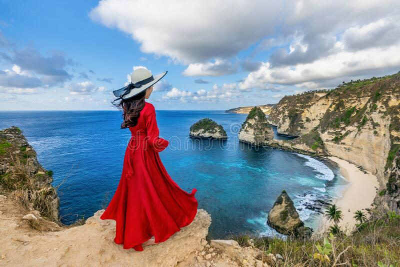 Woman standing on Diamond beach in Nusa penida island, Bali in Indonesia. royalty free stock image