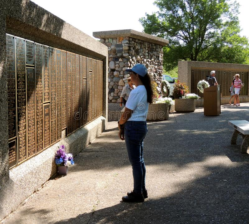 Woman Standing by the EAA Memorial Wall in Oshkosh WI remembering a loved one royalty free stock photos